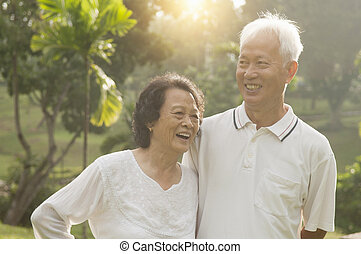 Asian seniors couple at outdoor park