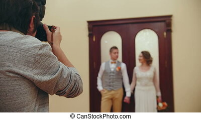 Wedding photographer - young married couple indoor, close up