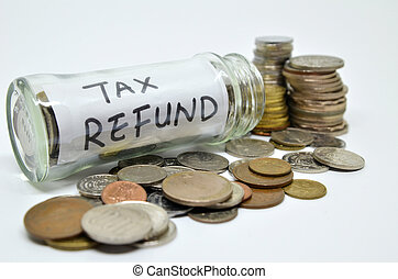 Tax refund lable in a glass jar with coins spilling out...