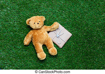 gift and teddy bear - brown gift and cute teddy bear lying...