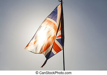 Union jack flying in the sky - Close up on UK flag