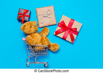 gifts and teddy bear in cart - small gifts and cute teddy...