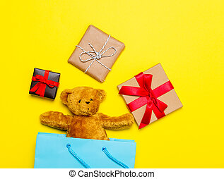 gifts and teddy bear in bag - small gifts and cute teddy...