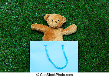 teddy bear in shopping bag - cute teddy bear in the blue...