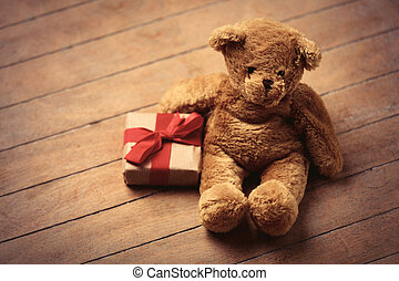 gift and teddy bear - beautiful gift and cute teddy bear on...