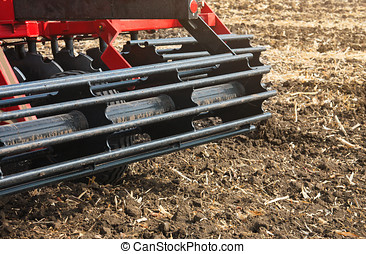 Agricultural machinery in the field. Stubble cultivator...