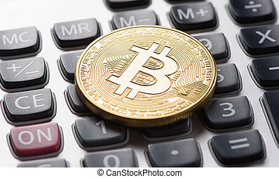 golden bitcoin on calculator - golden bitcoin coin on...