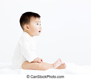 Adorable asian   smiling  baby  boy looking up