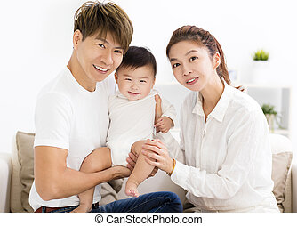 happy young asian family with sweet baby boy