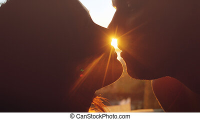 Romantic young beautiful couple in love looking each other...