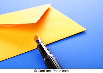 envelop and pen showing mail or communication concept