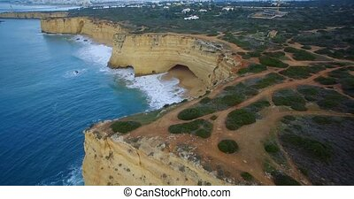 Aerial, Flying Along The Steep Cliff Line At Ferragudo,...