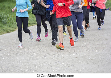 Fitness sport Group of people running jogging outside on road