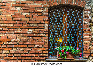 flowers on a window sill in Tuscany