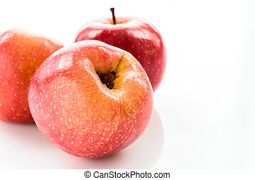 red apples over white background