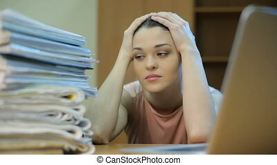 Overwhelmed office worker - Sad woman at office, with a lot...