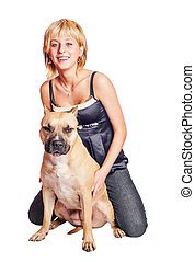 Woman and dog sitting together Fighting dog terrier and...