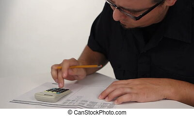 Calculator Work - Man works with paper, pencil and solar...