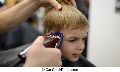 boy at barbershop for haircut