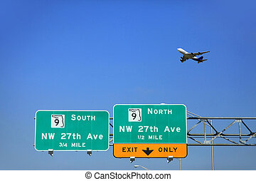 Signs on the road in Miami - and the plane in the sky