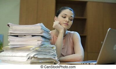 Heap of documents and worker - Sad woman at office, with a...