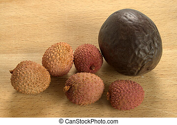 Lychees and Passion Fruit or Maracuya, on wooden background