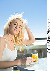 woman enjoying sunshine at breakfast
