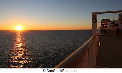 sunset on the deck of the ship and silhouettes of people
