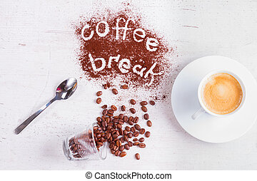 coffee break concept - cup of espresso, spoon and coffee...