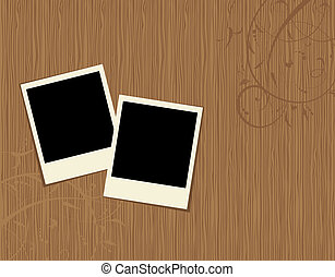 Two photo frames on wooden background