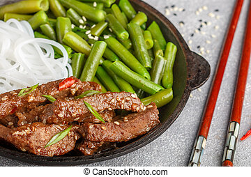 Fried spicy beef with sesame seeds, green beans and rice...