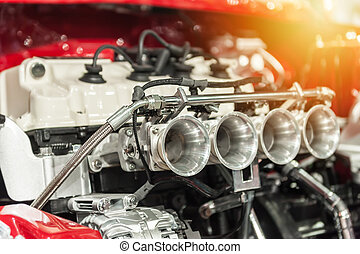 Engine of a hot rod in the sunlight