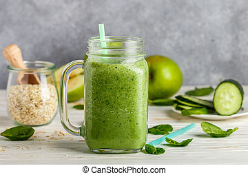 Fresh green smoothie from fruit and vegetables for a healthy lifestyle