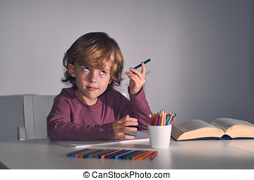 Child drawing in house