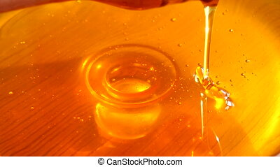 Honey Dripping from Hone Dipper - Slow motion of honey...