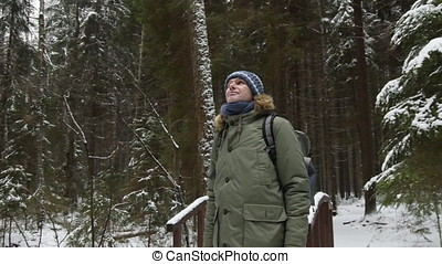 Man with backpack in a winter forest - Man in winter clothes...