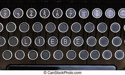 German Word Liebe on vintage type writer letter keys - Word...