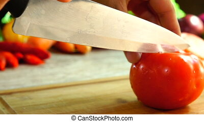 Tomato Cut Into Wedges - Close-up of female hands cut a...