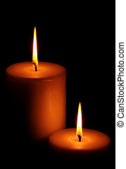 Two Burning candle - Two burning candles against dark...