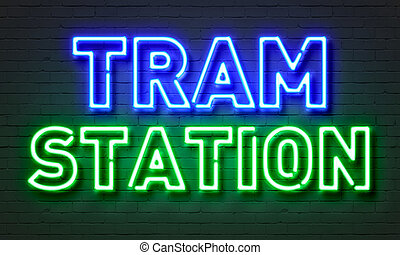 Tram station neon sign on brick wall background. - Tram...