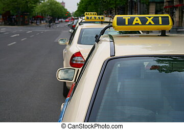 Taxis waiting in line, Berlin - A row of three taxis waiting...
