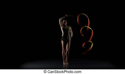 Flexible gymnast with tape creates beautiful hands graceful...