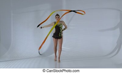 Gymnast circle around yourself with the tape in the hands....