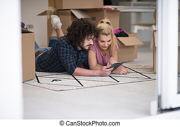 Young couple moving in a new flat