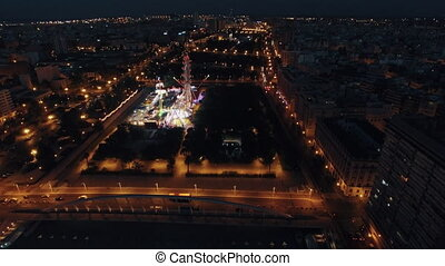 Flying over amusement park in night Valencia, Spain - Aerial...