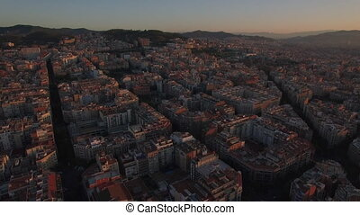 Flying over streets and houses of Barcelona - Aerial view of...