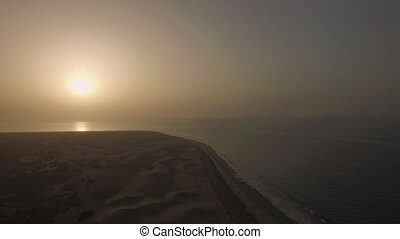Coast with sand dunes at sunset, Gran Canaria - Aerial view...