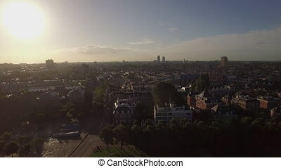 Flying over streets and houses of Amsterdam - Aerial...