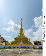 Golden pagoda and blue sky in Phra That Chae Haeng temple,...