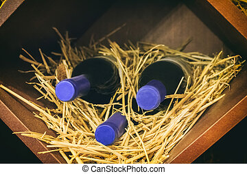 Wine bottles - Old wine bottles in wooden box with straw